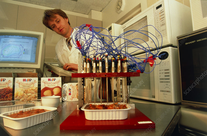 Researcher analysing food from a microwave