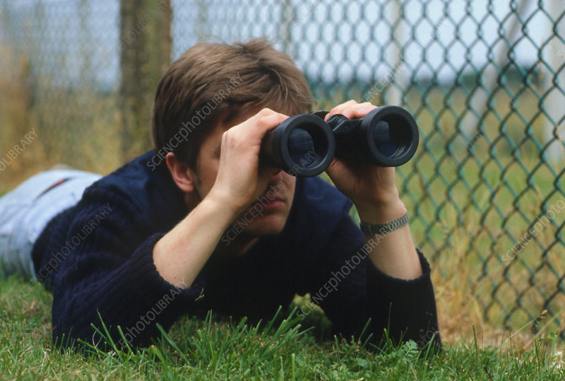 Man using pair of binoculars