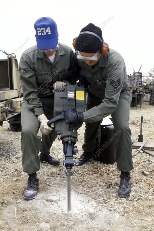 Soldiers using a pneumatic drill