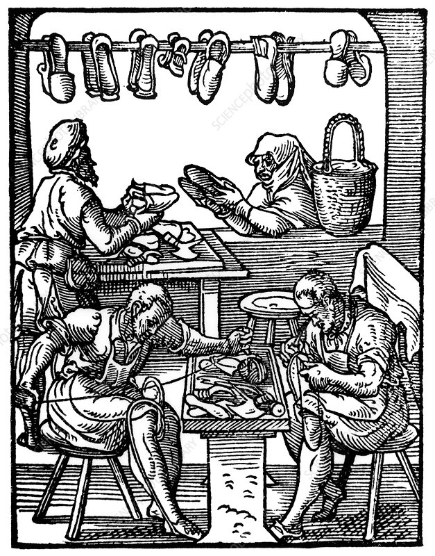 Engraving of cobblers making leather shoes.