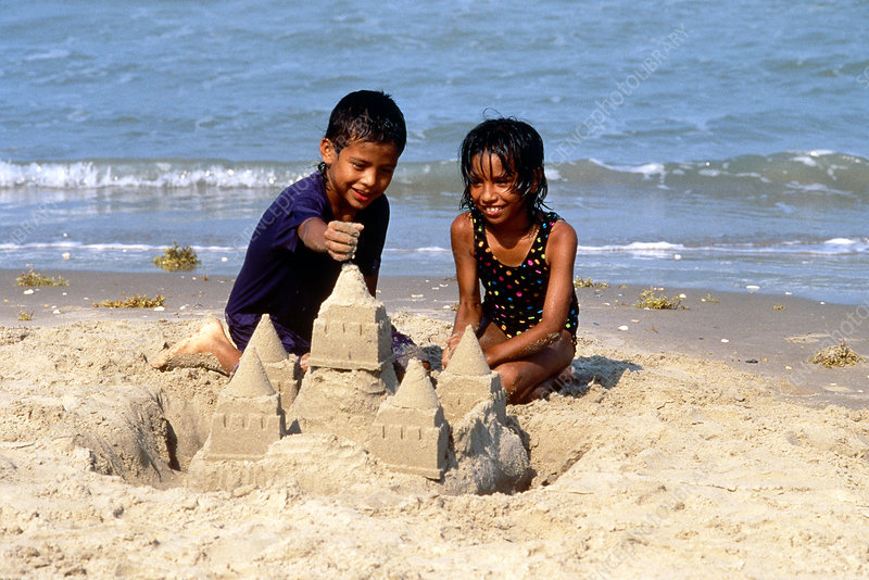 Children build sand castle, Texas Gulf Coast - Stock Image - P930 ...